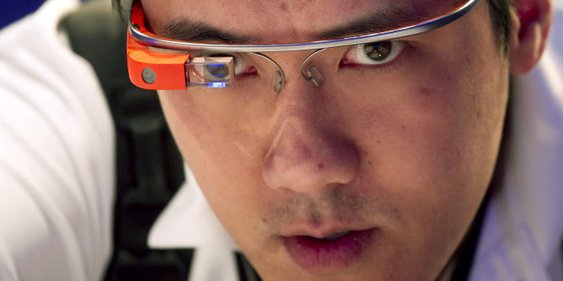 Vincent Nguyen, Editor in Chief of SlashGear, wears Google Glass while covering the introduction of the Microsoft Surface 2, Monday, Sept. 23, 2013 in New York. Microsoft is trying hard to succeed in tablets as personal computer sales are falling. (AP Photo/Mark Lennihan)